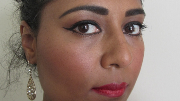 Dramatic Glamour with rosy cheeks full face side view